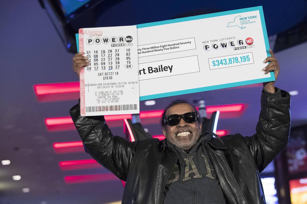 Robert Bailey poses for photographers during a news conference at the Resorts World Casino New York City, Wednesday, Nov. 14, 2018, in New York. The retired government worker won over $343 million ...