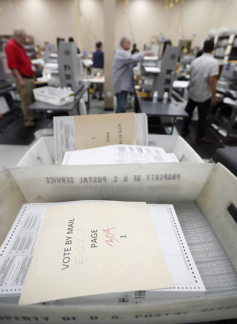 Employees at the Broward County Supervisor of Elections office recount ballots, Wednesday, Nov. 14, 2018, in Lauderhill, Fla. (AP Photo/Wilfredo Lee)