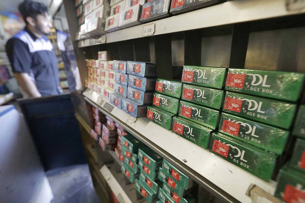 This May 17, 2018 file photo shows packs of menthol cigarettes and other tobacco products at a store in San Francisco. On Thursday, May 15, 2018, FDA Commissioner Dr. Scott Gottlieb pledged to ban ...