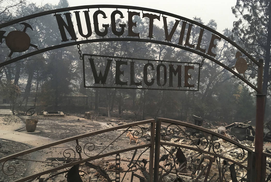 This Wednesday, Nov. 14, 2018 shows the remains of the Gold Nugget Museum, which was totally demolished by the Camp Fire, in Paradise, Calif. (AP Photo/Martha Mendoza, File)