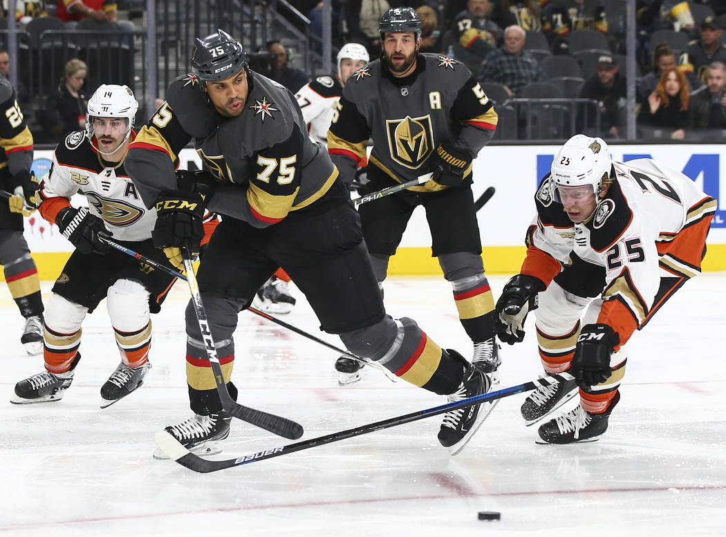 Golden Knights right wing Ryan Reaves (75) and Anaheim Ducks right wing Ondrej Kase (25) chase after the puck during the second period of an NHL hockey game at T-Mobile Arena in Las Vegas on Wedne ...