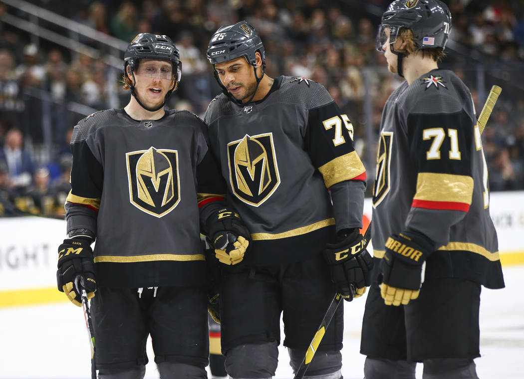 Golden Knights center Cody Eakin (21) talks with Golden Knights right wing Ryan Reaves (75) during the third period of an NHL hockey game against the Anaheim Ducks at T-Mobile Arena in Las Vegas o ...
