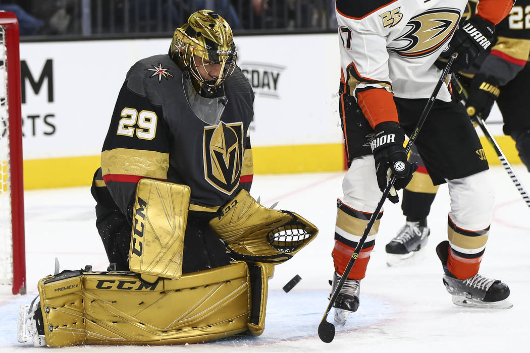 Golden Knights goaltender Marc-Andre Fleury (29) defends the net after losing his stick in front of Anaheim Ducks center Ryan Kesler (17) during the second period of an NHL hockey game at T-Mobile ...