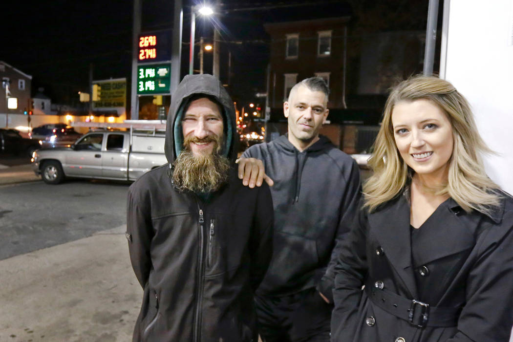 Johnny Bobbitt Jr., left, Kate McClure, right, and McClure's boyfriend Mark D'Amico pose at a Citgo station in Philadelphia. (Elizabeth Robertson /The Philadelphia Inquirer via AP, File) /The Ph ...