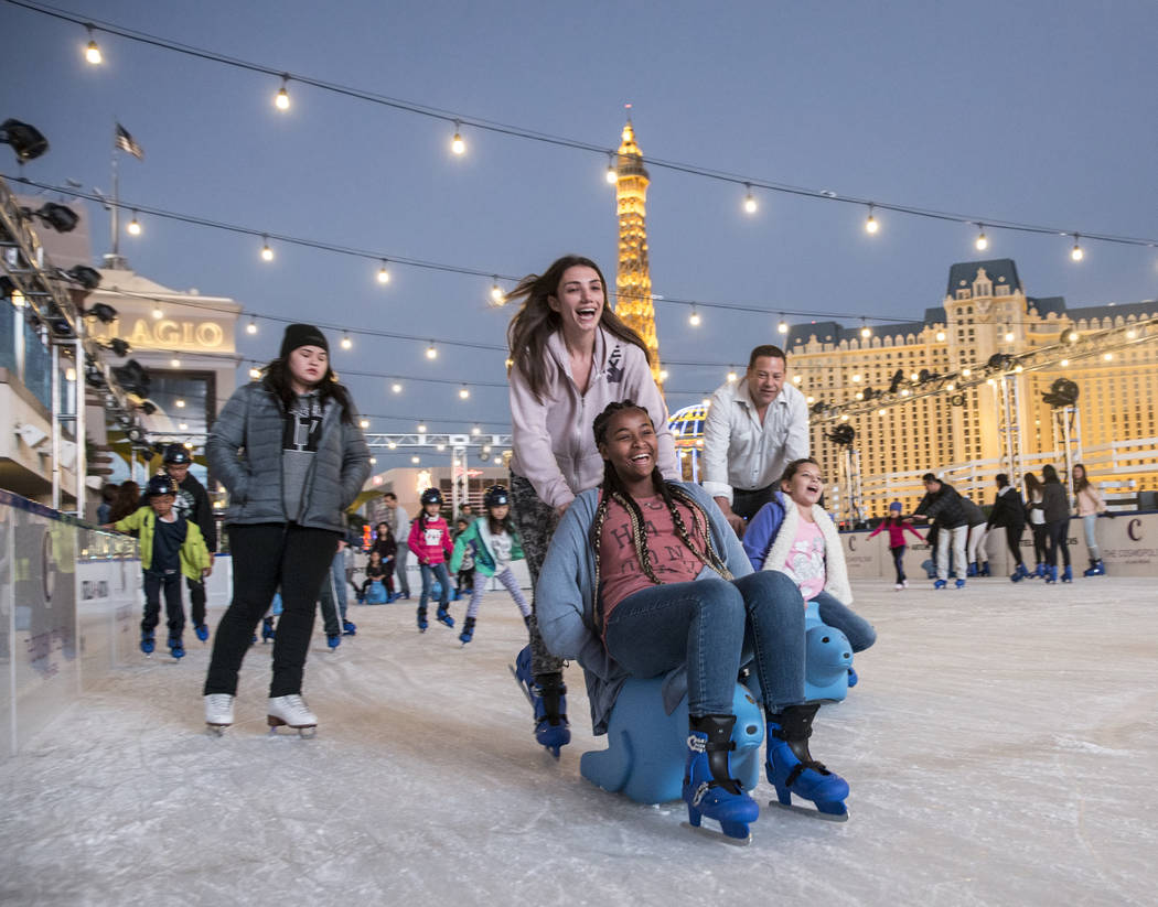 Skaters enjoy the last moments of light at dusk at the Cosmopolitan of Las Vegas Ice Rink on Monday, Nov. 21, 2016, in Las Vegas. (Benjamin Hager/Las Vegas Review-Journal)