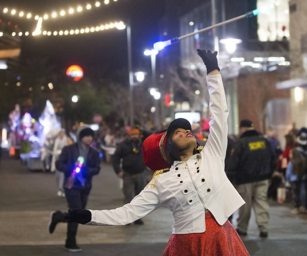 Baton twirlers perform during the Downtown Summerlin Holiday Parade on Festival Plaza Drive on Friday, Dec. 14, 2018, in Las Vegas. The parade features floats, dancers and festive holiday characte ...
