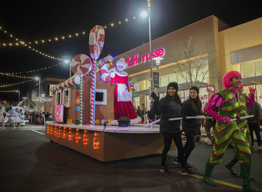 Mrs. Claus waves to the crowd during the Downtown Summerlin Holiday Parade on Festival Plaza Drive on Friday, Dec. 14, 2018, in Las Vegas. The parade features floats, dancers and festive holiday c ...