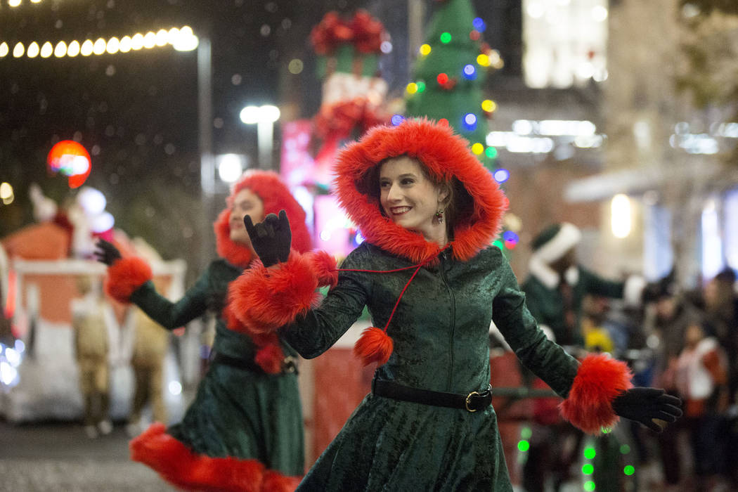 Performers wave to the crowd as the Downtown Summerlin Holiday Parade makes its way through Festival Plaza Drive on Friday, Dec. 14, 2018, in Las Vegas. The parade features floats, dancers and fes ...