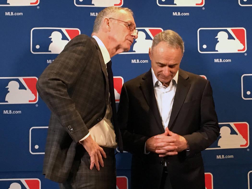 DAZN chairman John Skipper, left, speaks to Major League Baseball commissioner Rob Manfred at the baseball owners meeting in Atlanta, Thursday, Nov. 15, 2018. (AP Photo/Paul Newberry)