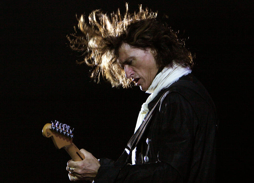 FILE - In this Saturday, June 2, 2007, file photo, American rock band Aerosmith's guitarist Joe Perry performs during a concert in Bangalore, India. Perry is hospitalized with breathing problems t ...