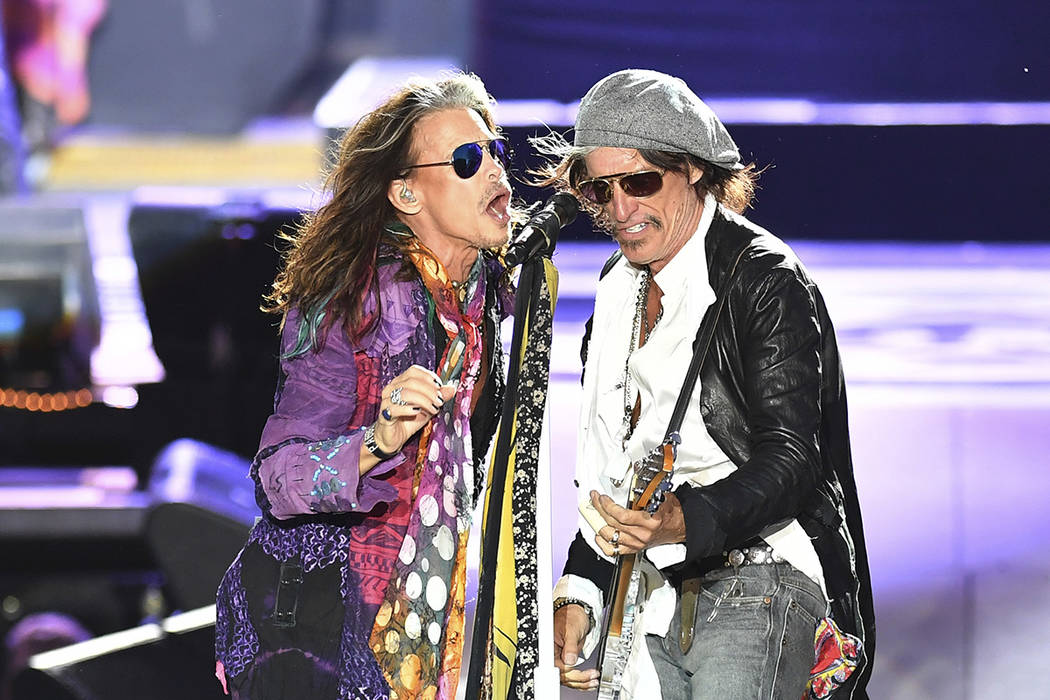 Singer Steven Tyler, left, and guitarist Joe Perry perform during a concert of Aerosmith at the Koenigsplatz in Munich, Germany, Friday, May 26, 2017. (AP Photo/Lukas Barth)
