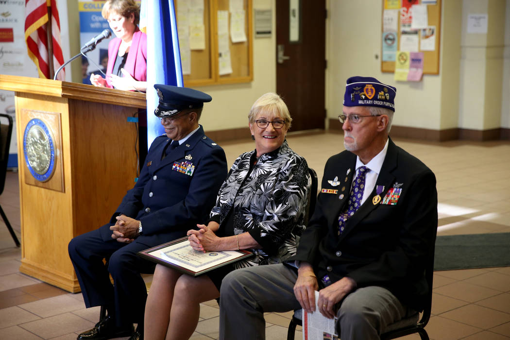 Charm McElree of Boulder City, who works with Operation Recognition, second from right, during a ceremony at the Sawyer Building in Las Vegas Thursday, Nov. 15, 2018. At McElree's right is Thomas ...