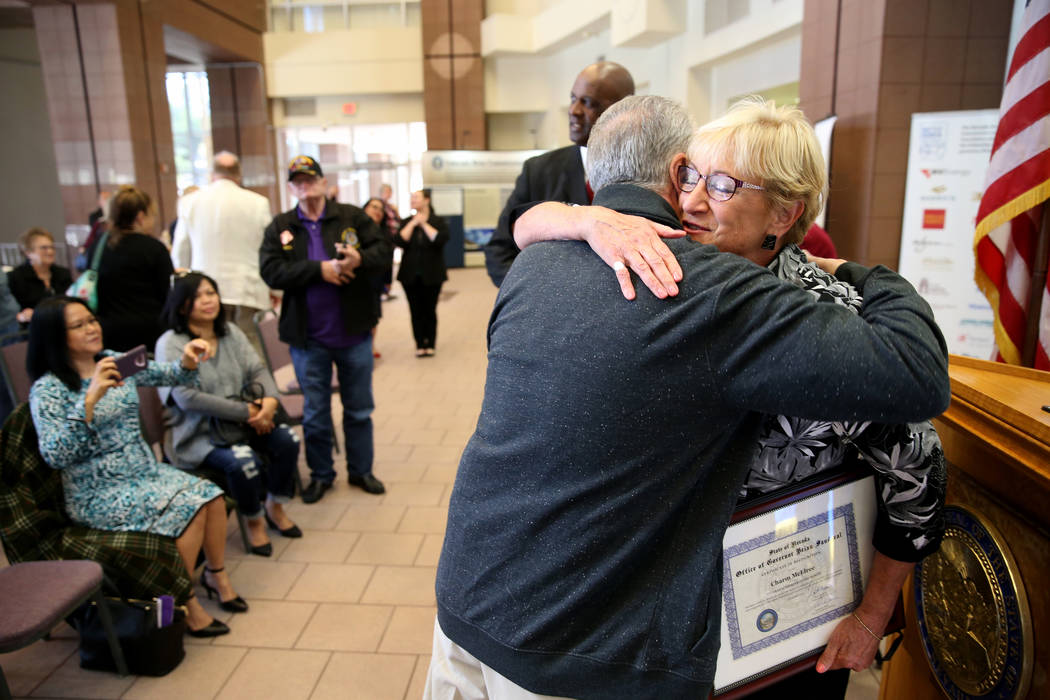 Charm McElree of Boulder City, who works with Operation Recognition, gets a hug from Vietnam veteran David DeRose during a ceremony at the Sawyer Building in Las Vegas Thursday, Nov. 15, 2018. Ope ...