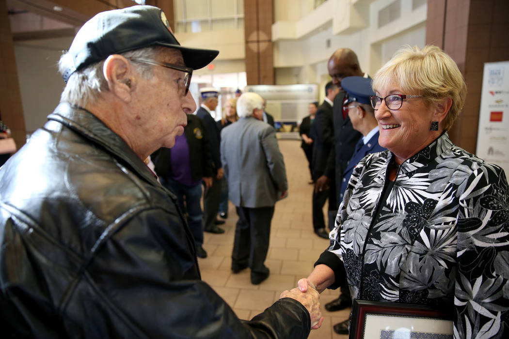 Charm McElree of Boulder City, who works with Operation Recognition, is thanked by Korean War veteran Sandy Epstein, 85, after a ceremony at the Sawyer Building in Las Vegas Thursday, Nov. 15, 201 ...
