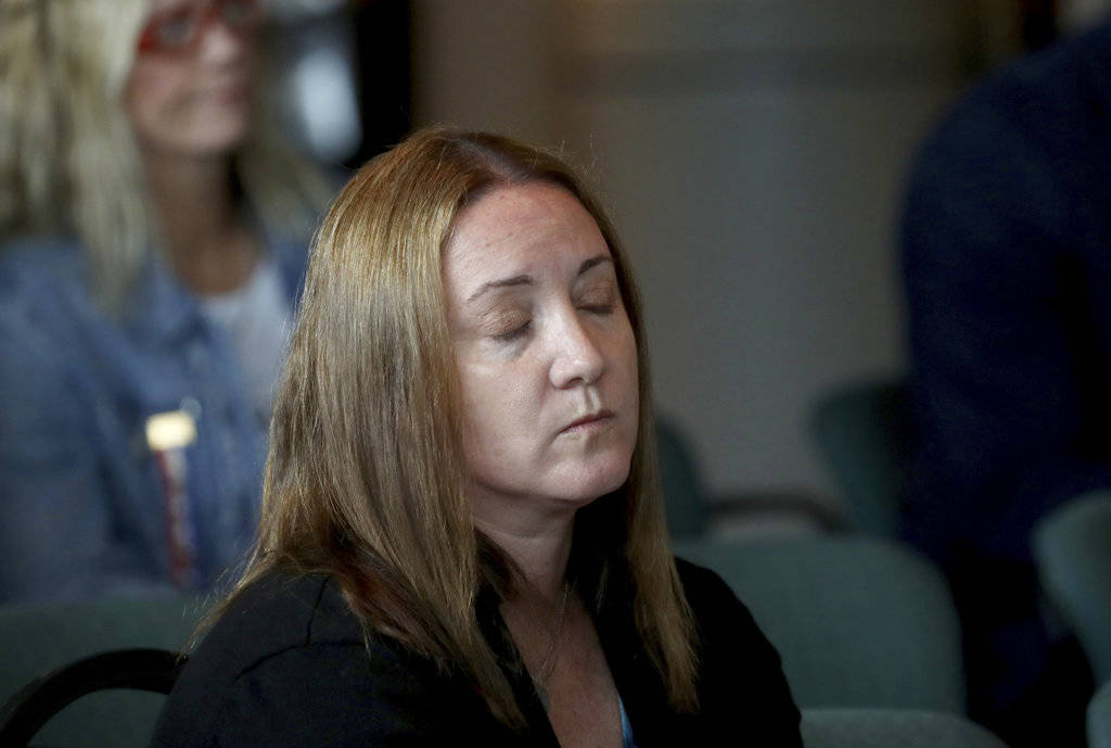 Lori Alhadeff, the mother of shooting victim Alyssa watches videos from the school shooting during the Marjory Stoneman Douglas High School Public Safety Commission meets Thursday, Nov. 15, 2018, ...