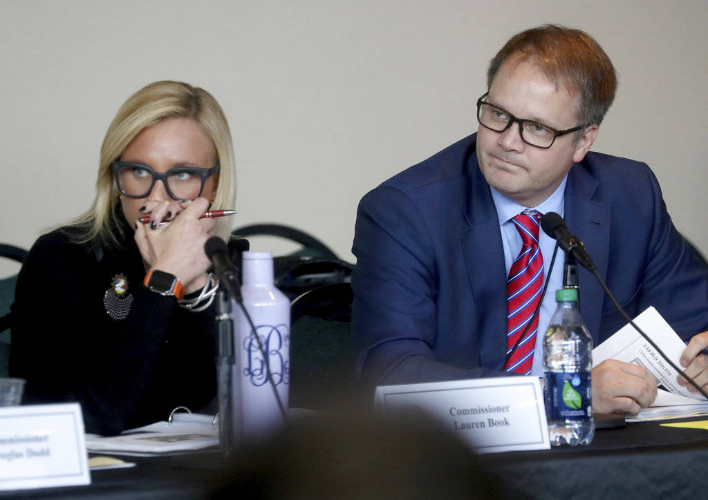 Florida Senator Lauren Book and Ryan Petty, the father of shooting victim Alaina Petty listen to videos from the school shooting during the Marjory Stoneman Douglas High School Public Safety Commi ...