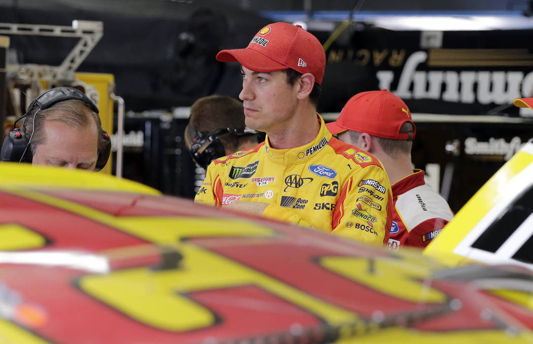 In this May 19, 2018, file photo, Joey Logano looks from the garage after practice for the NASCAR All-Star auto race at Charlotte Motor Speedway in Concord, N.C. Logano is one NASCAR's four title ...