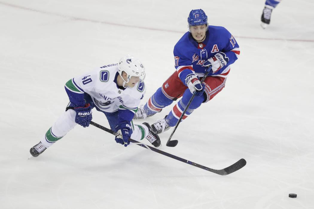 8d428d652 Vancouver Canucks  Elias Pettersson (40) fights for control of the puck  with New