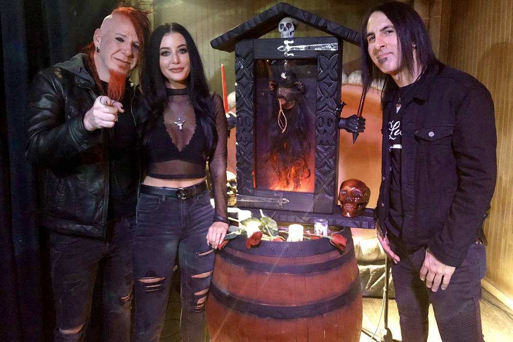 Vinnie Paul's girlfriend, Chelsey Yeager, is shown with members of Hellyeah Chad Gray and Christian Brady during Paul's memorial celebration at The Golden Tiki on Sunday, Nov. 11, 2018. (Hew Burney)
