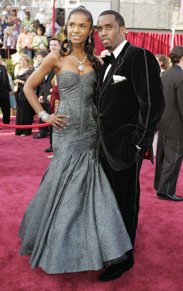 "Sean ""P. Diddy"" Combs arrives with Kim Porter for the 77th Academy Awards Sunday, Feb. 27, 2005, in Los Angeles. (AP Photo/Amy Sancetta)"