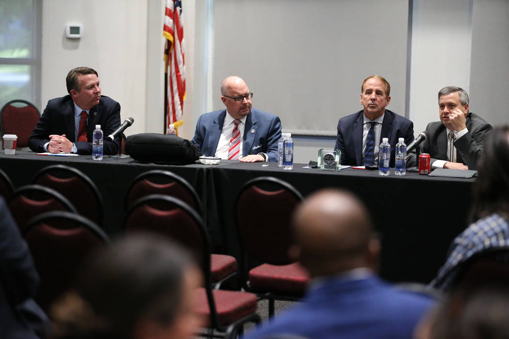 Nevada System of Higher Education's Chief General Counsel Joe Reynolds, from left, Regent Kevin Page, Chancellor Thomas Reilly, and Vice Chairman Regent Jason Geddes, during a public forum to disc ...