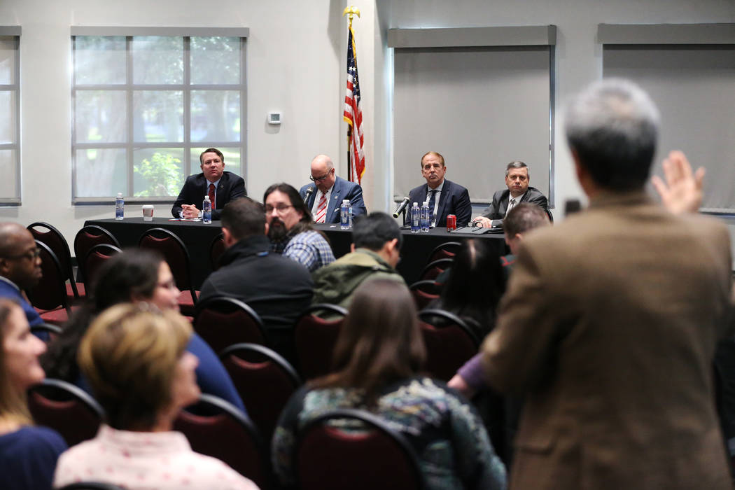 Nevada System of Higher Education's Chief General Counsel Joe Reynolds, from left, Regent Kevin Page, Chancellor Thom Reilly, and Vice Chairman Regent Jason Geddes, during a public forum to discus ...