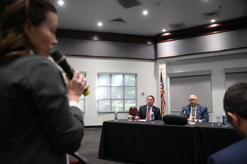 Nevada System of Higher Education's Chief General Counsel Joe Reynolds, left, and Regent Kevin Page, listen to public comments during a forum to discuss the search for a new UNLV president, at UNL ...