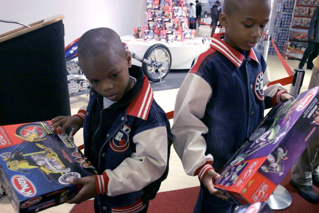 FILE - In this Nov. 22, 2005 file photo, Timothy Sessoms, left, 7, and his brother Akiim Sessoms, 10, hold gifts of K'Nex toy chopper bikes at FAO Schwarz in New York. Three years after it closed ...
