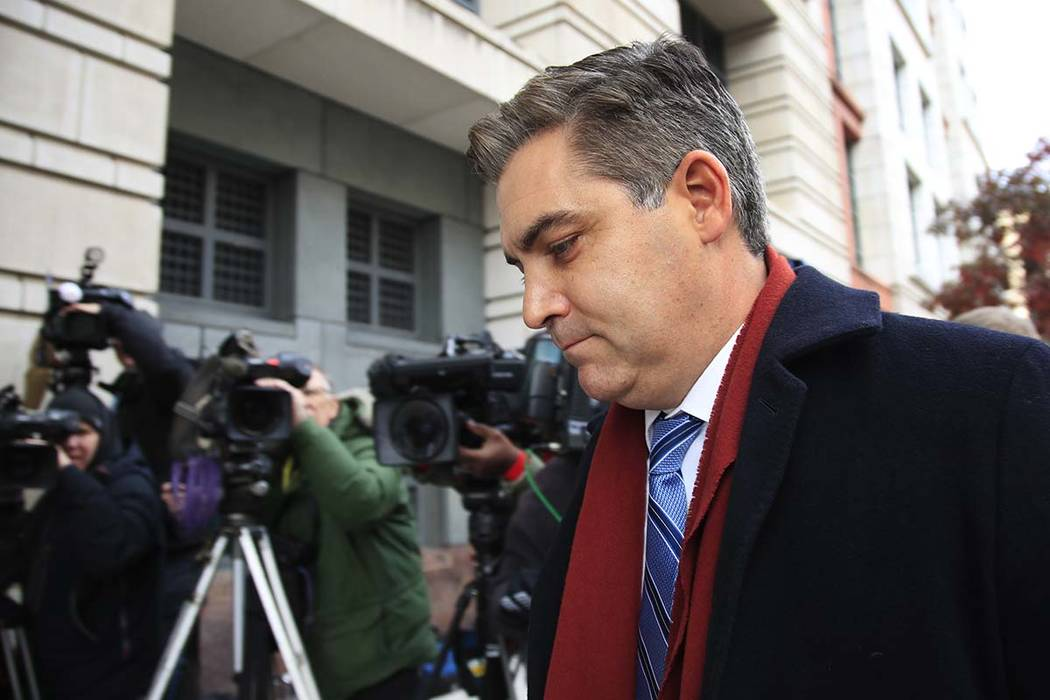 In this Nov. 14, 2018, photo, CNN's Jim Acosta walks into federal court in Washington, to attend a hearing on a legal challenge against President Donald Trump's administration. (AP Photo/Manuel Ba ...