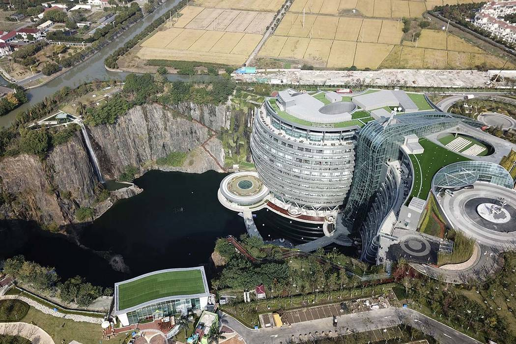 This Nov. 13, 2018, aerial photo and released on Thursday, Nov. 16, 2018 by Xinhua News Agency, shows the Intercontinental Shanghai Wonderland Hotel in Songjiang district of Shanghai, east China. ...