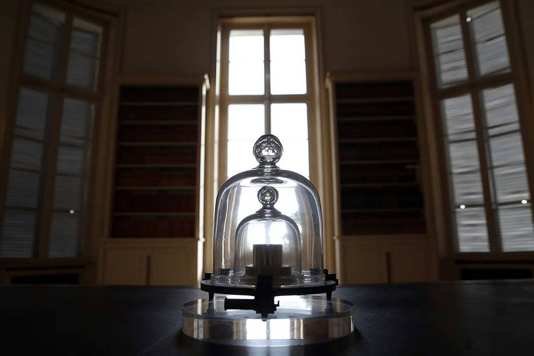 In this photo taken Wednesday, Oct. 17, 2018, a replica of the International Prototype Kilogram is pictured at the International Bureau of Weights and Measures in Sevres, near Paris. The golf ball ...