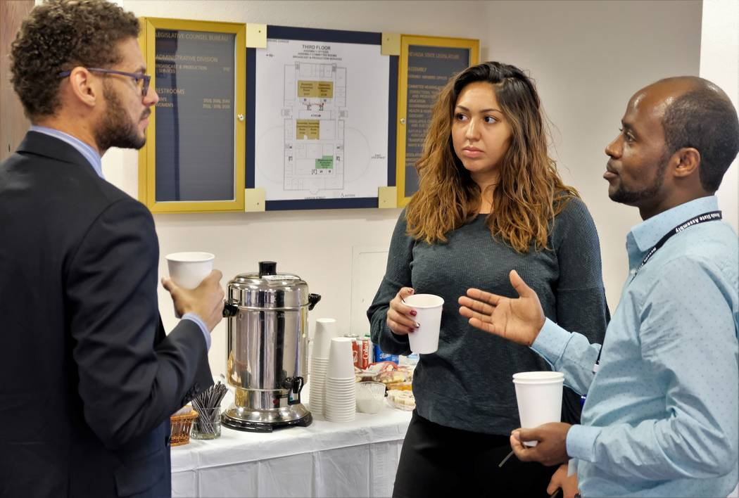 Incoming Nevada Assembly members Howard Watts, left, Selena Torres, center, and Alexander Assefa, right, chat over coffee during a break between training sessions at orientation for freshman lawma ...