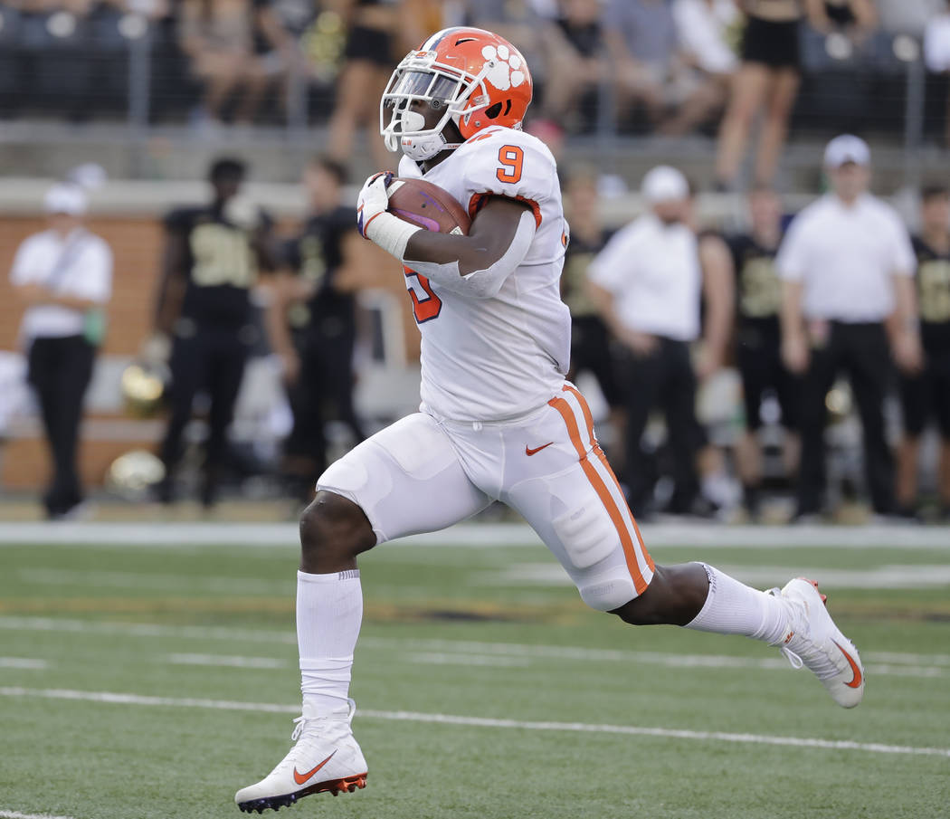 FILE - In this Oct. 6, 2018, file photo, Clemson's Travis Etienne runs for a touchdown against Wake Forest during an NCAA college football game in Charlotte, N.C. Etienne is the one running back l ...