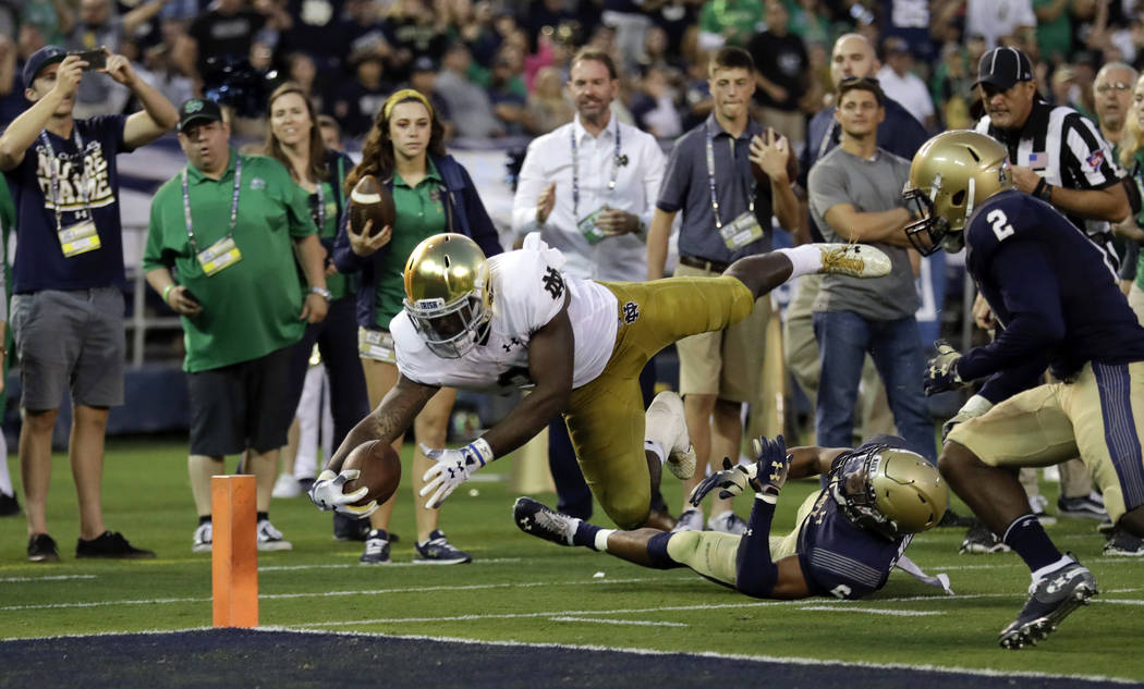 FILE - In this Oct. 27, 2018, file photo, Notre Dame running back Dexter Williams leaps into the end zone for a touchdown during the first half of an NCAA college football game against Navy in San ...