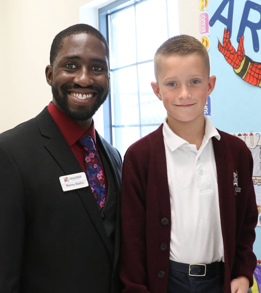 Manuel Mathis, a 2nd-grade teacher at Challenger School-Silverado campus, poses for a photo with his student Carson Redford on Friday, Nov. 16, 2018, in Las Vegas. Mathis won a national Crayola cr ...