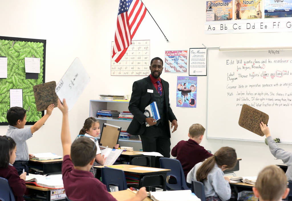 Manuel Mathis, a 2nd-grade teacher at Challenger School-Silverado campus, teaches math on Friday, Nov. 16, 2018, in Las Vegas. Mathis won a national Crayola crayons contest, based on a student nom ...