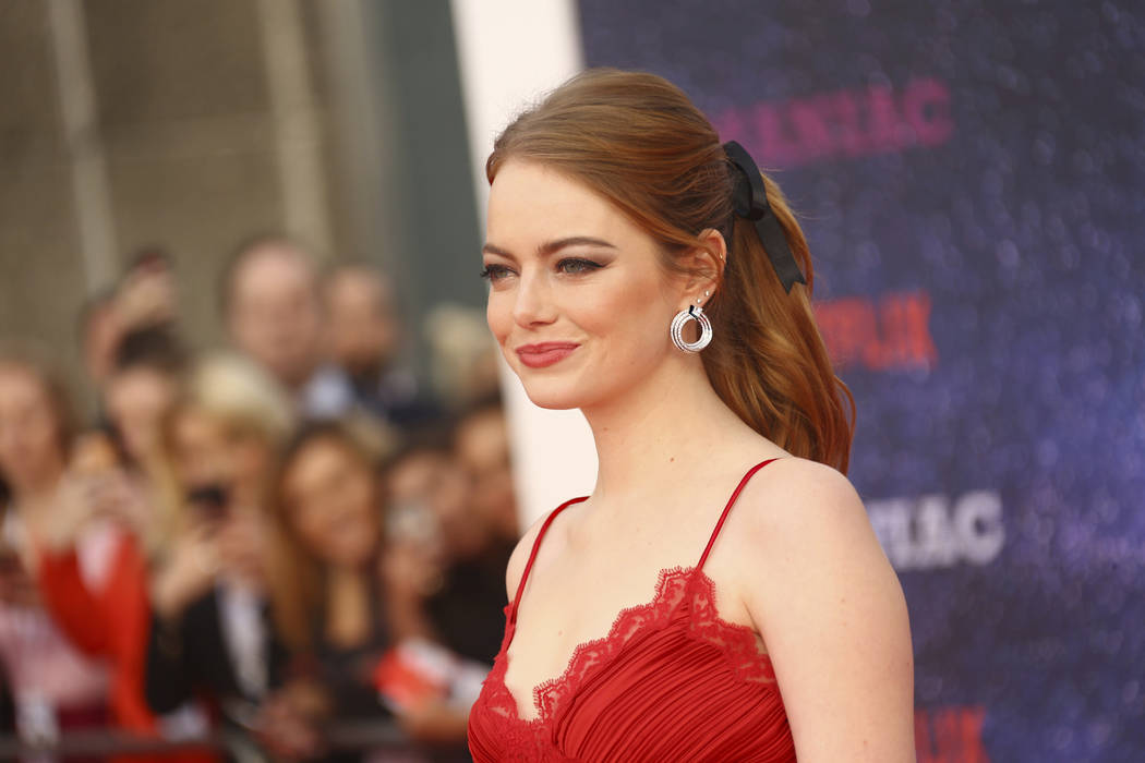 Actress Emma Stone poses for autographs at the world premiere of the television series 'Maniac' in London, Thursday, Sept. 13, 2018. (Photo by Joel C Ryan/Invision/AP)