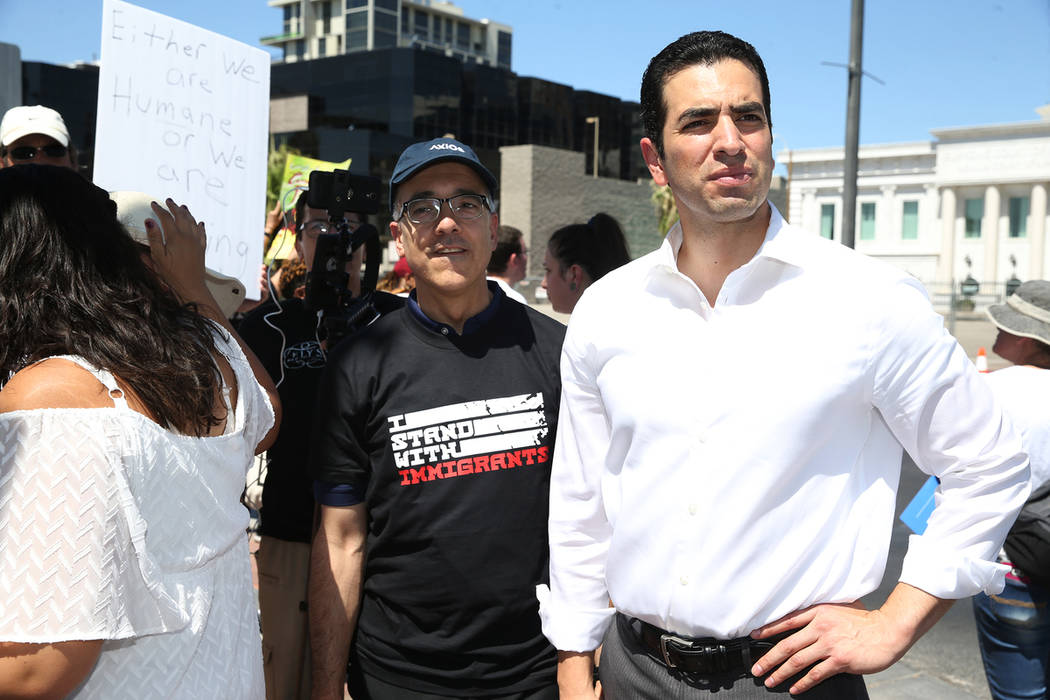 Nevada state Sen. Mo Denis, left, and U.S. Rep. Ruben Kihuen, D-Nev., during a rally against the separation of immigrant families outside of the Lloyd George U.S. Courthouse in Las Vegas, Saturday ...