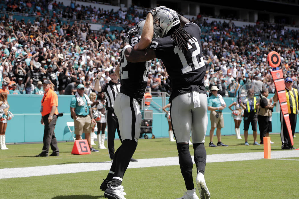 Oakland Raiders wide receiver Jordy Nelson, left, is congratulated by wide receiver Martavis Bryant (12) after scoring a touchdown during the first half of an NFL football game against the Miami D ...