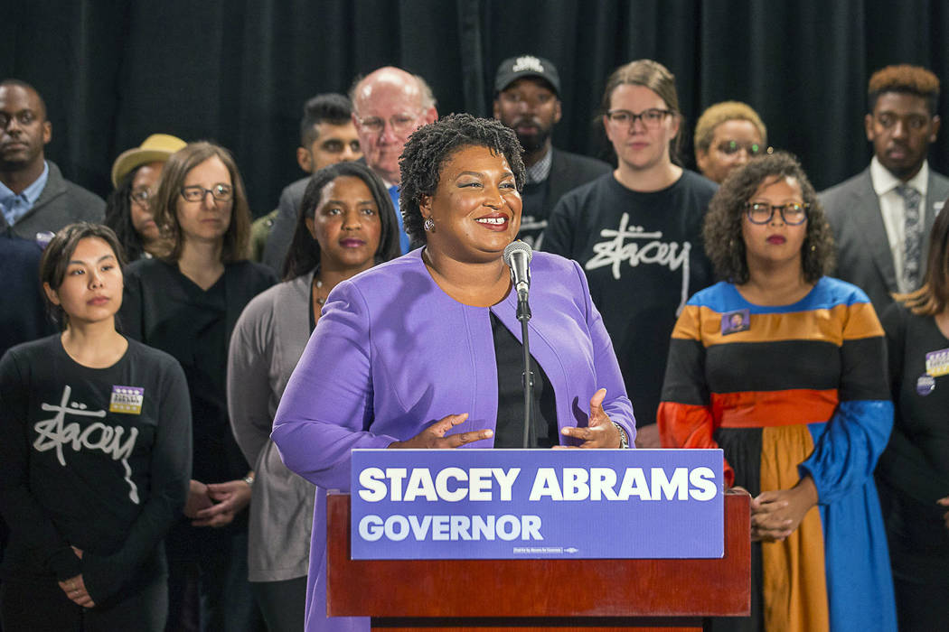 Georgia gubernatorial candidate Stacey Abrams makes remarks during a press conference at the Abrams Headquarters in Atlanta, Friday, Nov. 16, 2018. Abrams says she will file a federal lawsuit to c ...