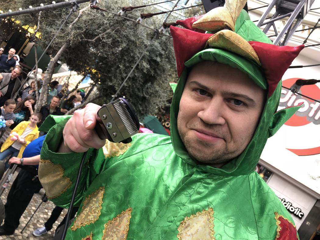 Piff the Magic Dragon means business at the St. Baldrick's shave-a-thon at New York-New York on Saturday, March 10, 2018. (John Katsilometes/Las Vegas Review-Journal) @JohnnyKats
