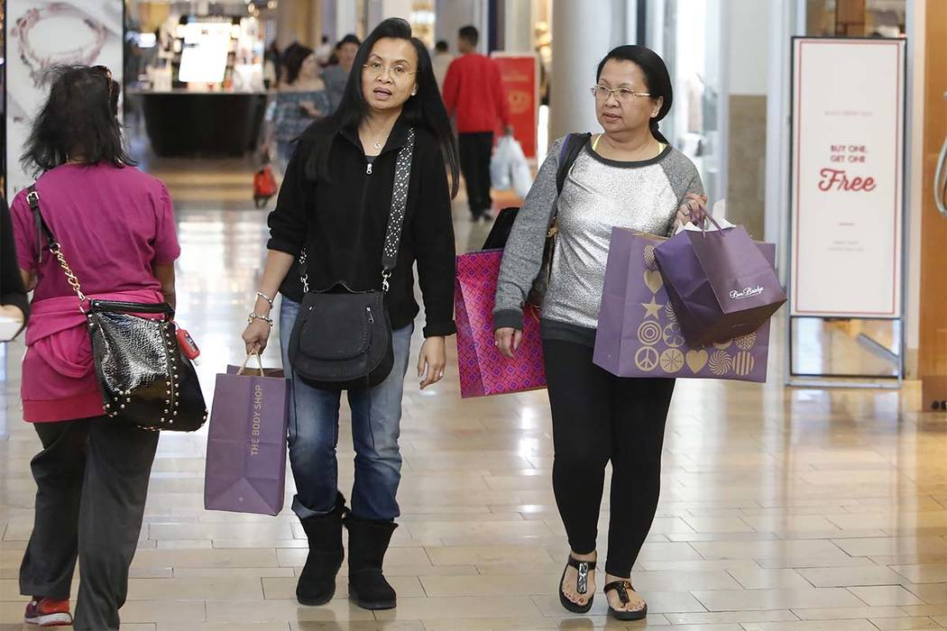 Geri H, center, and her sister Loby P, who declined to give their last names, shop at the Fashion Mall Show on the Strip on Black Friday, Nov. 24, 2017, in Las Vegas. Bizuayehu Tesfaye Las Vegas R ...