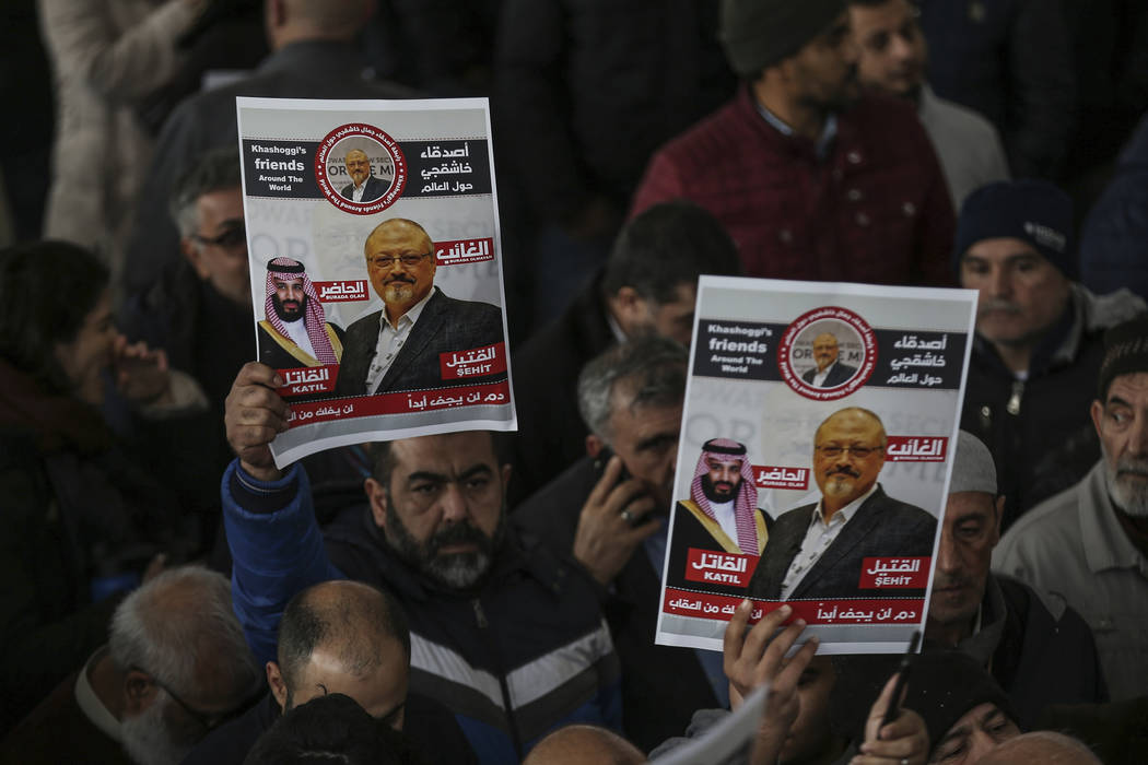The members of Arab-Turkish Media Association and friends hold posters as they attend funeral prayers in absentia for Saudi writer Jamal Khashoggi who was killed last month in the Saudi Arabia con ...