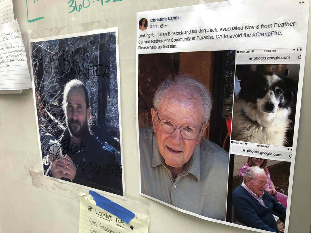 In this Nov. 13, 2018 file photo, messages are shown on a bulletin board at The Neighborhood Church in Chico, Calif., as evacuees, family and friends search for people missing from the northern Ca ...
