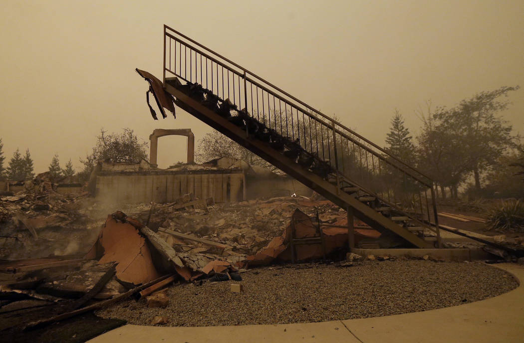 In this Friday, Nov. 9, 2018, file photo a staircase that once led to another level is seen among the burned remains of home that was destroyed by a wildfire that swept through the area in Paradis ...