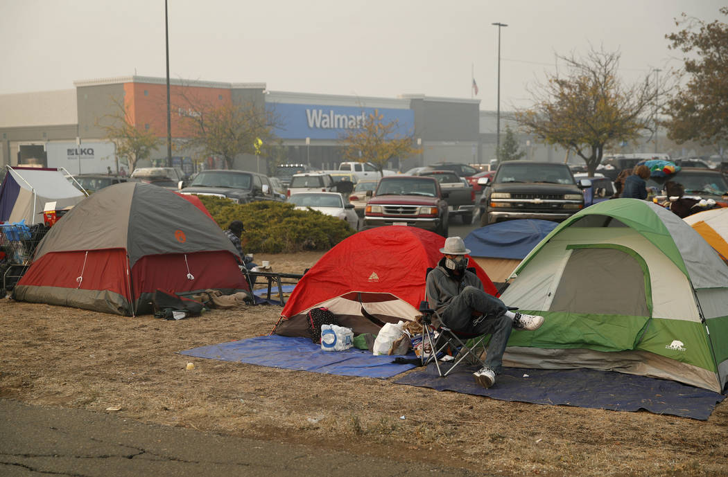 People Sit By Their Tents At A Makeshift Encampment Outside Walmart Store For Displaced