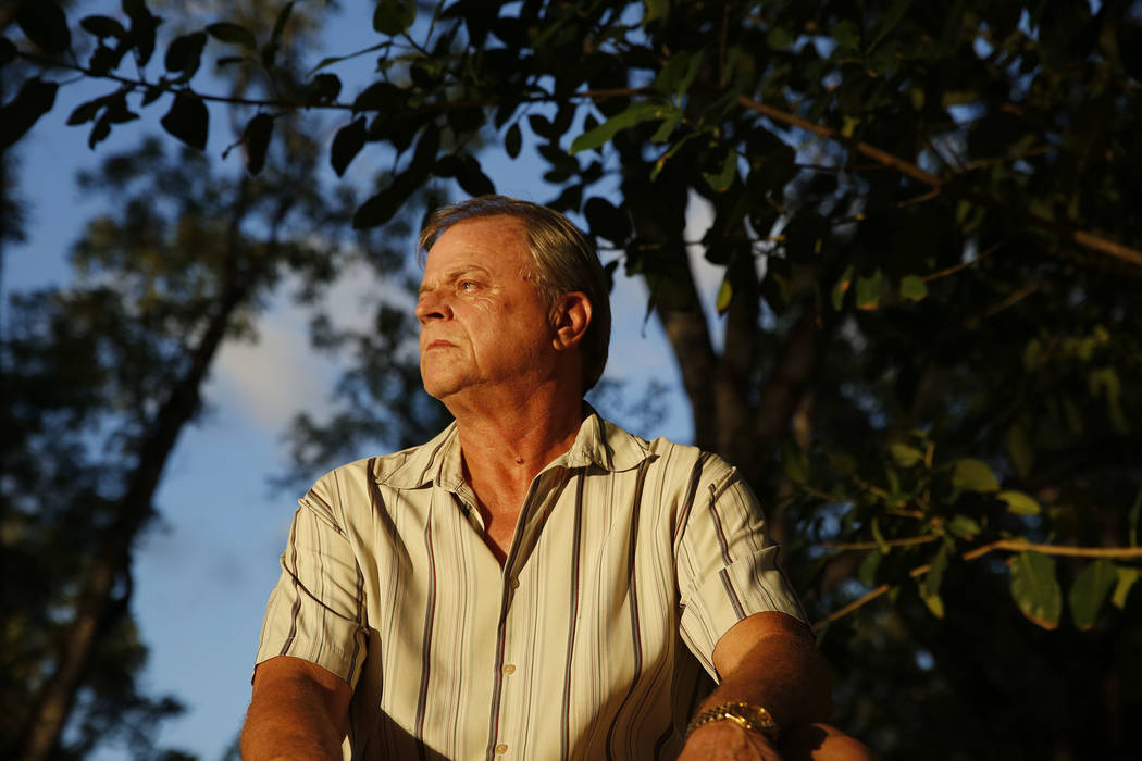 Mike Touchette, a survivor of the Jonestown massacre in Guyana, poses for a portrait on Monday, Nov. 12, 2018, in Miami Springs, Fla. (AP Photo/Brynn Anderson)