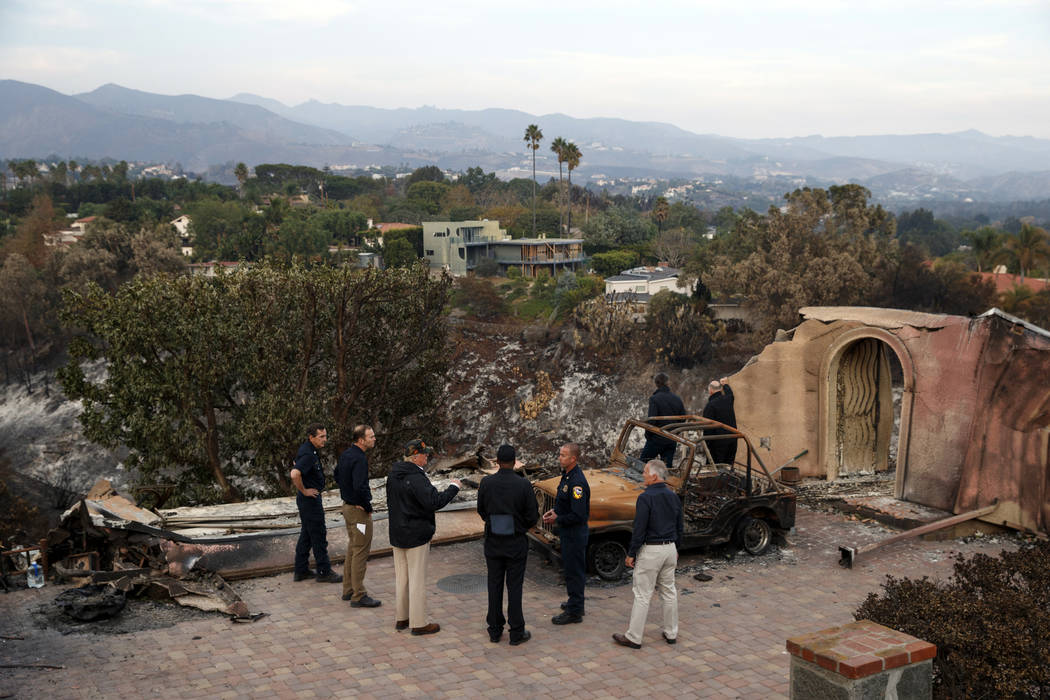 President Donald Trump visits a neighborhood impacted by the Wolsey Fire, Saturday, Nov. 17, 2018, in Malibu, Calif. (AP Photo/Evan Vucci)