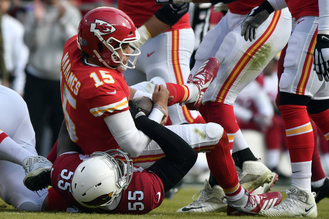 Arizona Cardinals defensive end Chandler Jones (55) sacks Kansas City Chiefs quarterback Patrick Mahomes (15) during the first half of an NFL football game in Kansas City, Mo., Sunday, Nov. 11, 20 ...