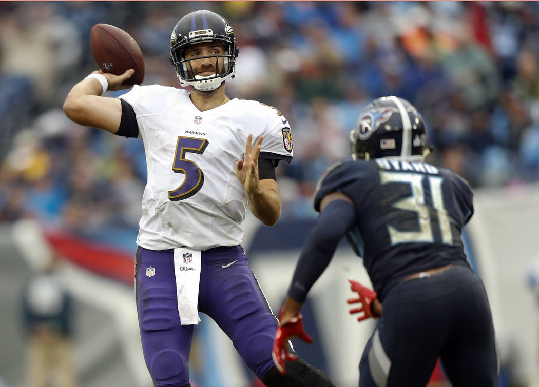 Baltimore Ravens quarterback Joe Flacco (5) passes as he is pressured by Tennessee Titans safety Kevin Byard (31) in the second half of an NFL football game Sunday, Oct. 14, 2018, in Nashville, Te ...